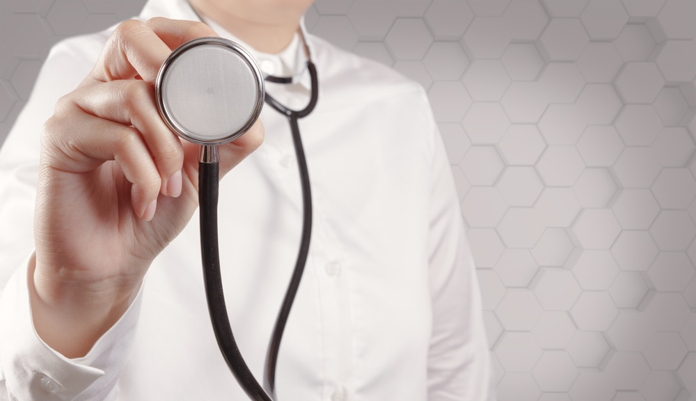 Doctor with a stethoscope in the hands-1
